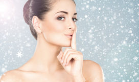 Close-up portrait of attractive and happy caucasian woman on the snow Royalty Free Stock Photography