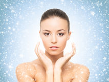 Close-up portrait of attractive and happy caucasian woman on the snow Royalty Free Stock Photo