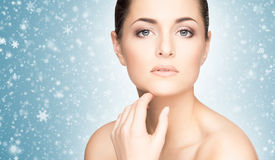 Close-up portrait of attractive and happy caucasian woman on the snow Stock Photo
