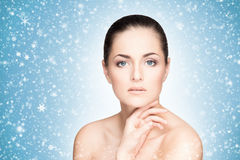 Close-up portrait of attractive and happy caucasian woman on the snow Royalty Free Stock Images