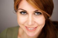 Beautiful mature woman with gray eyes stock image