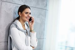 Close up portrait of attractive smiling businesswoman at workplace royalty free stock images