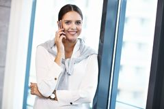 Close up portrait of attractive smiling businesswoman at workplace royalty free stock photography