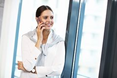 Close up portrait of attractive smiling businesswoman at workplace royalty free stock photo