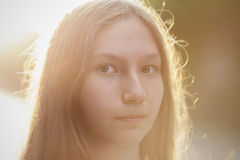 Close up portrait of attractive teen girl in sunset Royalty Free Stock Photography
