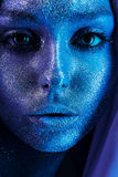 Close up portrait of attractive woman with blue bodyart Royalty Free Stock Photos
