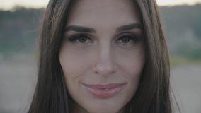 Close up portrait of attractive woman smiling. Closeup of happy brunette stock video footage