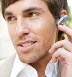 Businessman with ear set. Royalty Free Stock Images