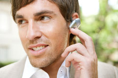 Businessman with ear set. Stock Images