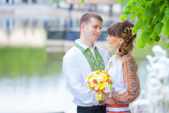 Close up portrait of attractive young couple in outdoor park. Royalty Free Stock Images