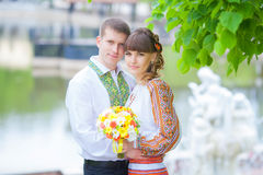 Close up portrait of attractive young couple piggybacking outdoo Royalty Free Stock Photos