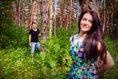 Close up portrait of attractive young couple piggybacking outdoors. Royalty Free Stock Image