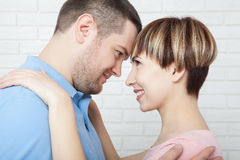 Close up portrait of attractive young couple on white background. Royalty Free Stock Images
