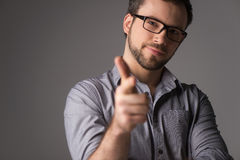 Close-up portrait of attractive young man showing gun sign. Stock Images