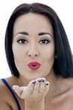 Close Up Portrait of an Attractive Young Woman Blowing a Kiss Stock Photography