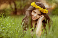Close-up portrait of an attractive young woman outdoors, lying i Royalty Free Stock Photography