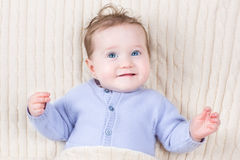 Close up portrait of baby in blue knitted sweater Royalty Free Stock Photos
