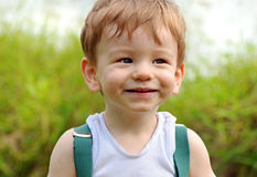 Close up portrait baby boy cheeky smiling face expression Stock Photography