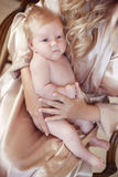 Close-up portrait of baby lying on mother hand. mom and child co Stock Photos
