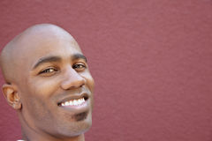 Close-up portrait of bald African American man over colored background Royalty Free Stock Photo