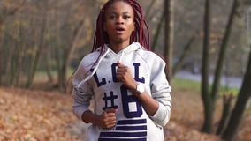 Close-up portrait of the beauitful afro-american girl jogging. Close-up portrait of the beauitful afro-american girl jogging stock video footage