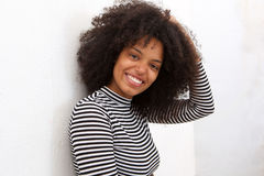 Close up beautiful african american woman with hand to curly hair Stock Photo