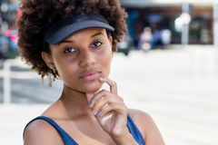 Close up portrait of a beautiful african american young adult woman stock images