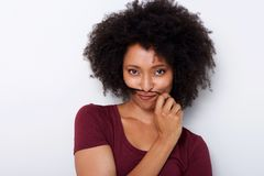 Close up beautiful african woman holding hair on face like moustache. Close up portrait of beautiful african woman holding hair on face like moustache Royalty Free Stock Photo