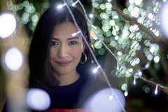 Beautiful Asian woman on a background with bokeh color lights,Blurry lights effect royalty free stock images