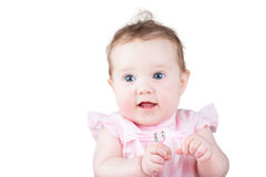Close up portrait of a beautiful baby girl in a pink dress Royalty Free Stock Photos
