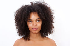 Close up portrait beautiful black woman with bare shoulders staring Royalty Free Stock Image
