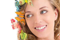 Close up portrait of beautiful blond with butterflies in her hai Stock Photos