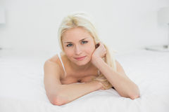 Close up portrait of a beautiful blond lying in bed Royalty Free Stock Photography