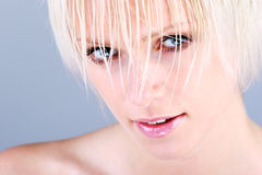 Close-up portrait of a beautiful blond woman royalty free stock photography