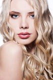 Close-up portrait of beautiful blonde. With curly hair royalty free stock images