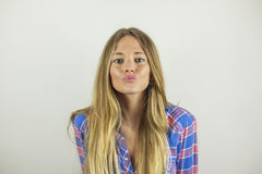 Close up portrait of beautiful blonde woman making a kissy face Royalty Free Stock Image