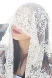 Close-up portrait of a beautiful bride hidden veil Royalty Free Stock Image
