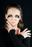 Close-up portrait of beautiful brunette. With green eye shadow mask Stock Photos