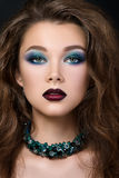 Close-up portrait of beautiful brunette woman with modern fashion make up Royalty Free Stock Images