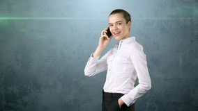 Close up portrait of beautiful businesswoman, standing by side and talking on mobile phone. Isolated studio background. Stock Photo