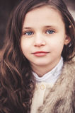 Close up portrait of beautiful child girl looking at camera Royalty Free Stock Image