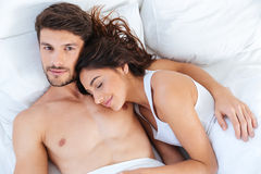 Close-up portrait of a beautiful couple lying in bed Stock Photography