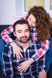 Close up portrait of beautiful couple sitting on sofa Royalty Free Stock Image