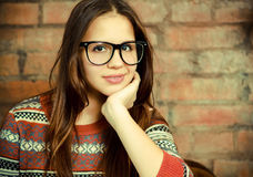 Close up portrait of a beautiful cute teen girl. Wearing glasses in the living room Royalty Free Stock Photos