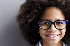 Close-up portrait of a beautiful dark-haired girl with glasses royalty free stock image