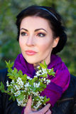 Close up portrait of beautiful dreamy woman with flowers Royalty Free Stock Image