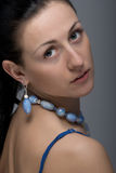 Close up portrait of gorgeous woman wearing jewelry Royalty Free Stock Photography