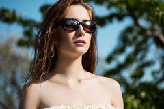 Close-up portrait of beautiful and fashion woman in sunglasses,. Studio shot. Professional makeup and hairstyle Stock Photos