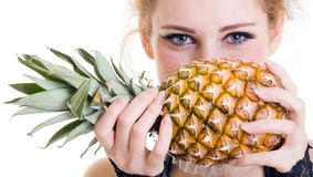 Close-up portrait of beautiful female with pineapp Royalty Free Stock Photography