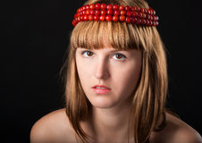 Close-up portrait of beautiful girl in chaplet Royalty Free Stock Photo